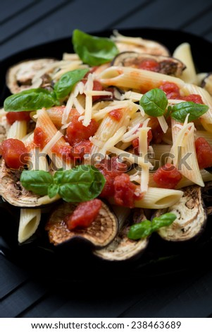 Close-up of pasta alla Norma, italian dish with eggplant