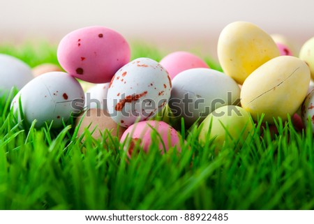 Close-up of pastel colored Easter eggs on grass - stock photo