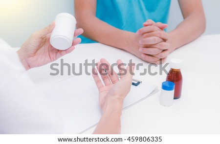 Close up of patient and doctor prescribing medication,medical background,medical concept and selective focus. - stock photo