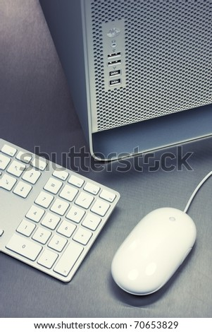 Close-up of PC desktop, keyboard, mouse on metal background - stock photo