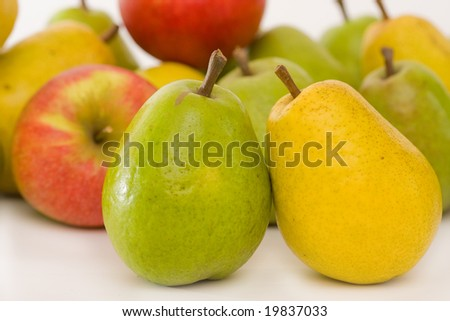 close up of pears on fruity colors background