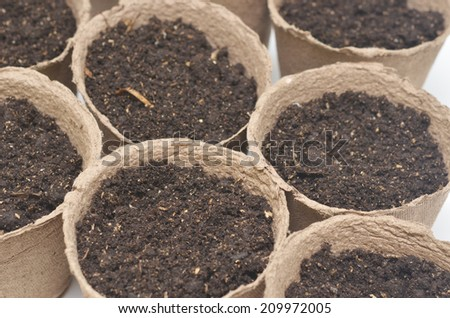 close up of peat pots with soil - stock photo