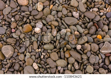 Close up of pebbles on a beach - stock photo