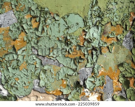 close-up of peeling painted wall of old factory - stock photo