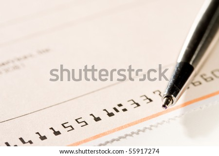 Close up of pen and check. - stock photo