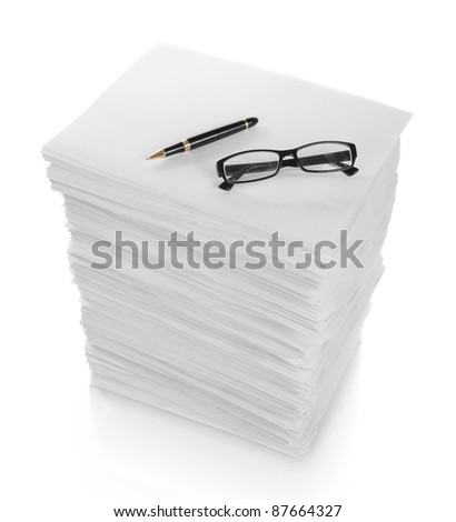 close up of pen and glasses in a stack of papers on white background - stock photo