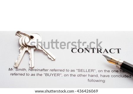 Close-up of pen on contract and keys