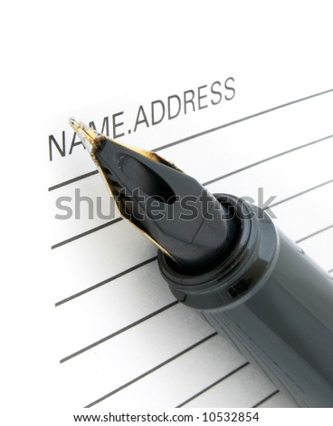 close-up of pen tip and address book - stock photo