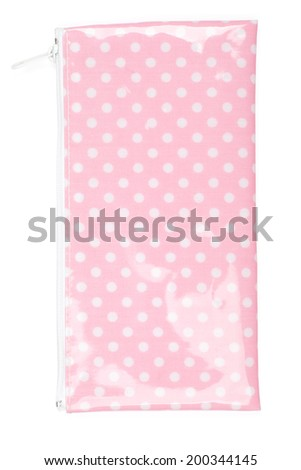 Close up of pencil case made of polka-dotted pink fabric, isolated on white