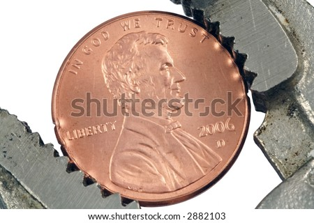 Close up of penny in locking pliers - stock photo