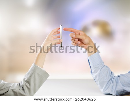Close up of people hands using mobile phone - stock photo