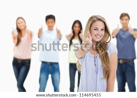 Close-up of people smiling and approving with one woman in foreground against white background - stock photo