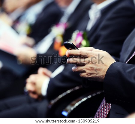 Close up of people using mobile smart phone - stock photo