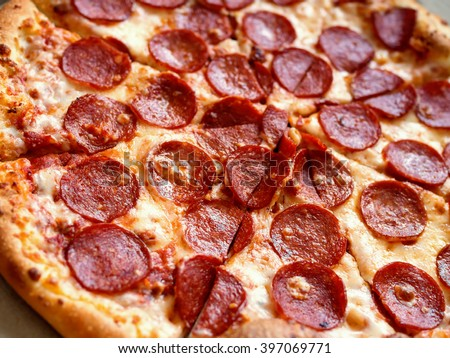 Close-up of pepperoni pizza, shallow depth of field - stock photo