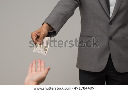 Close-up Of Person Hand Giving Money To Other Hand, hand to hand money pass,Money from hand in business suit to another hand