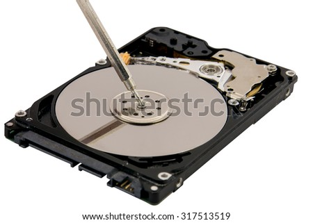 Close-up Of Person Hands Repairing Hard disk Using Screwdriver - stock photo