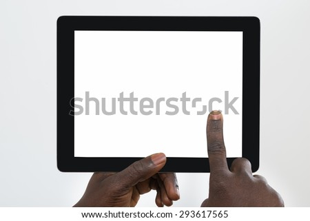 Close-up Of Person's Hand Using Digital Tablet With Blank Screen