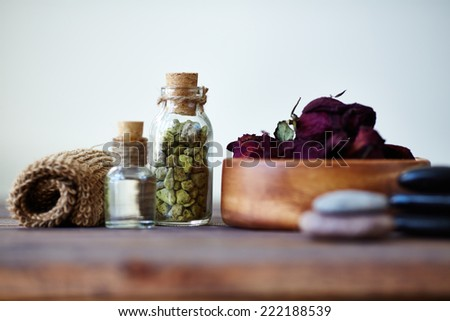 Close-up of petals and oil for aromatherapy - stock photo