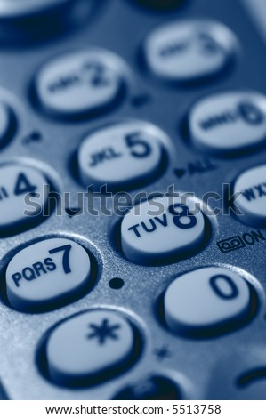 Close-up of Phone Keypad. Very shallow depth of field. Focus on letters RS7 and TUV. Visible texture of plastic. - stock photo
