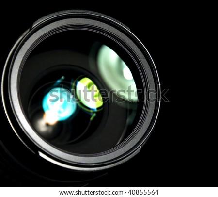 Close up of photo camera lens on black - stock photo