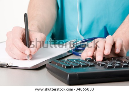 Close-up of physician hand with pen over blank paper during work - stock photo