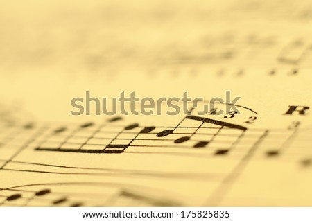 Close up of piano classic music score and notes and old paper - stock photo