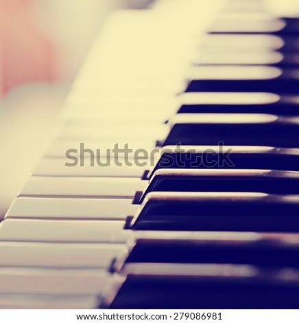 close-up of piano keys. close frontal view. - stock photo