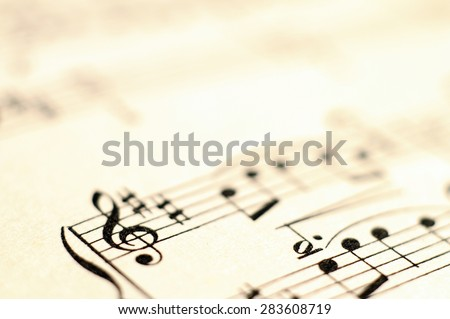 Close up of piano music score and notes and old paper - stock photo