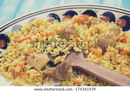 Close-up of pilaf with pork meat, horizontal shot