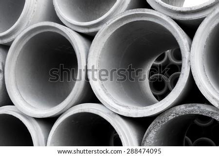 Close up of pile of concrete pipes - stock photo