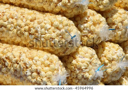 close-up of pile of large plastic bags of bright yellow popcorn - stock photo
