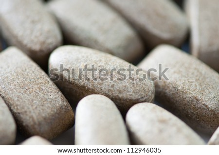 Close-up of pills, shallow DOF - stock photo