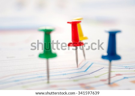 Close up of pin on graph data. business finance concept. - stock photo
