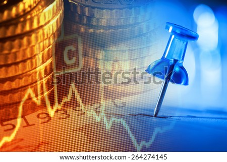 Close up of pin on graph data. Finance concept. - stock photo