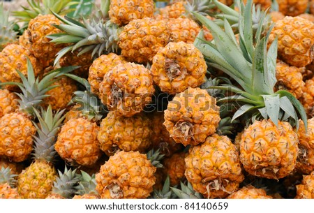Close up of pineapples on market stand