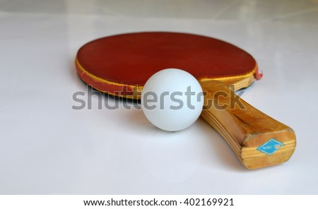 close up of ping-pong or table tennis racket with ball - stock photo