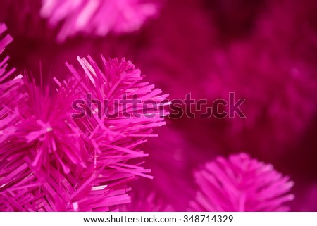 Close up of pink artificial tree branches with selective focused point for holiday season background - stock photo