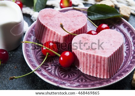 Close up of pink heart shaped freeze ice cream with cherries