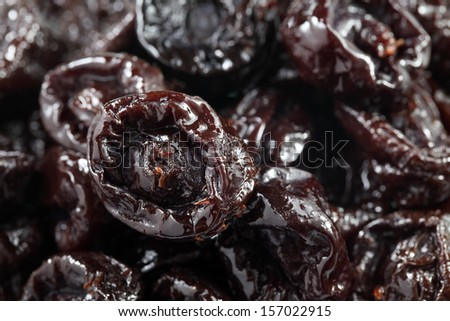 Close up of pitted prunes in whole background. - stock photo