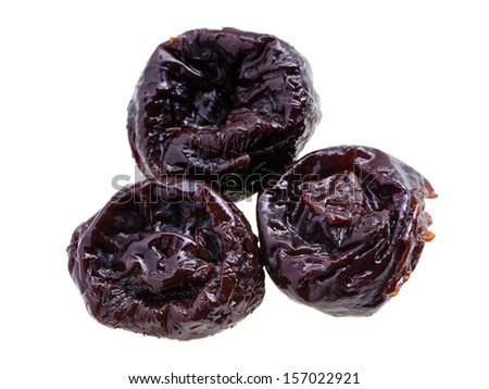 Close up of pitted prunes isolated on white background. - stock photo