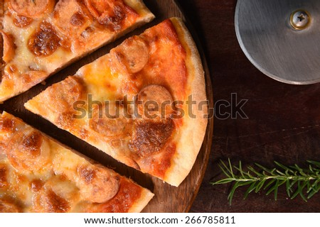 close up of pizza on wooden background