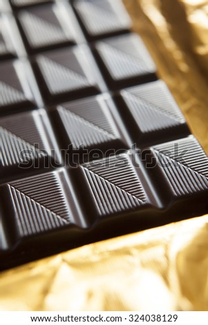 Close Up Of Plain Chocolate Bar On Foil Wrapper