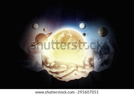 Close up of planet sun system in your hand
