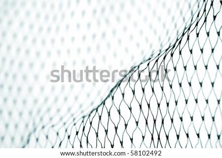 Close-up of plastic fishing net - stock photo