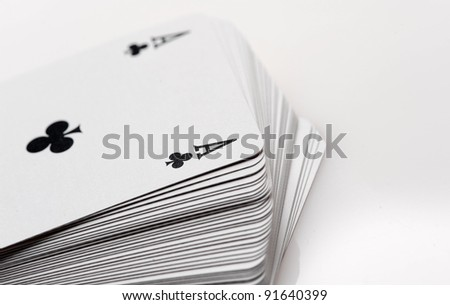 close up of playing cards poker game on white background - stock photo