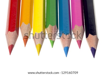 Close-up of pointed crayon color pencils isolated on white background - stock photo