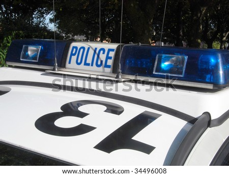 Close-up of police car sign in city center - stock photo