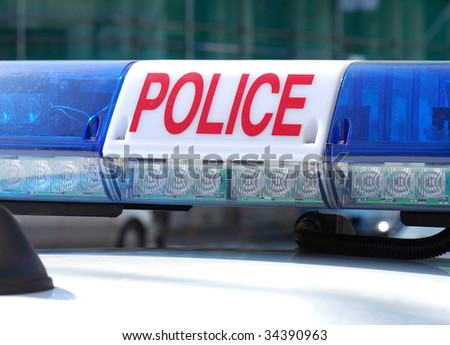 Close-up of police car sign in city centre - stock photo