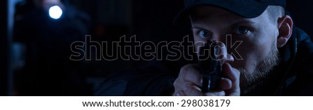 Close up of policeman aiming to the bandit - stock photo