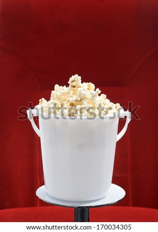 close up of popcorn bucket made of plastic over red background